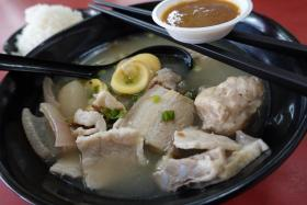 Mr Chuk Kee and his Vietnamese-born wife Kim hawk pork soup in a corner stall at Chinatown Complex Food Centre. The signature Monan Pork Soup (above, $3.80) with belly pork, lean meat, egg sausage, meatball, radish and greens, and the ribs version ($5.80) are must-trys.