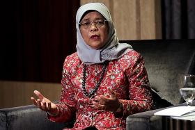 Halimah asks for more virus aid for the vulnerable