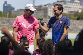 Roger Federer (right) and Rafael Nadal taking part in a Roger Federer Foundation Learning through Play session with South African children ahead of the Match in Africa Cape Town charity event on Friday.