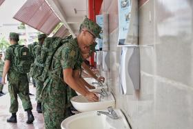 SAF monitoring soldiers' temperature, staggering meal times
