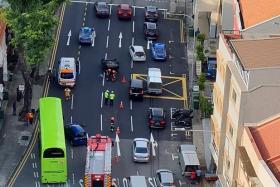 Car flips over after crash in Jalan Besar, driver crawls out