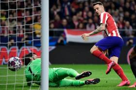 Atletico Madrid's Saul Niguez bundling the ball home after a corner for the only goal of the game.