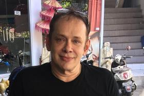 Australia's worst paedophile began his activities in Singapore in 2001