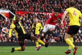 Forward Mason Greenwood (in red) unleashing a piledriver in the 75th minute to score Manchester United's third goal against Watford on Sunday (Feb 23).