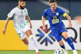 On Thursday, Asian Champions League matches featuring Iranian clubs, such as Ali Dashti's Esteghlal (in blue), were postponed as Iran became the latest nation to be severely affected by the coronavirus epidemic.