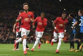 Bruno Fernandes (far left) celebrates with his teammates after scoring Manchester United's first goal.