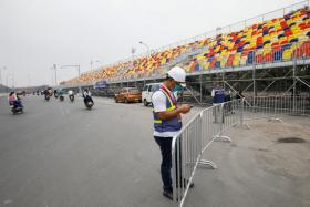 A man with a mask working at the Vietnam GP racing track in Hanoi on Thursday.