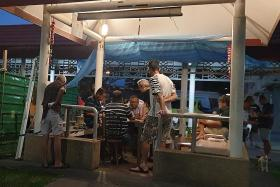 Men gather at HDB pavilion to gamble late into the night