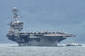 US Navy evacuates sailors from coronavirus-struck aircraft carrier