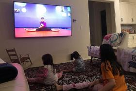 US children stuck at home embrace online exercise classes