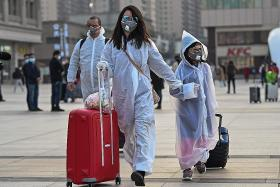 China relaxes curbs on Wuhan but new coronavirus cases double