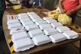 Packets of food delivered to migrant workers staying in dormitories by volunteers under the Covid Migrant Support Coalition's initiative
