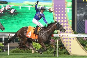 Jockey Glen Boss celebrating his victory aboard Lim's Cruiser in the 2018 Group 1 Lion City Cup at Kranji.