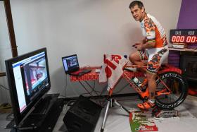 Ultra-triathlete Pascal Pich has covered 8,000km on a stationary bike on rollers in his living room.