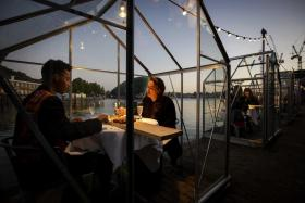 Dinner is served during a test evening in so-called quarantine greenhouses in Amsterdam, The Netherlands, 05 May 2020. Cultural institution Mediamatic wants to let guests dine coronaproof in the greenhouses.