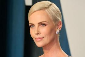 US-South African actress Charlize Theron attends the 2020 Vanity Fair Oscar Party following the 92nd annual Oscars at The Wallis Annenberg Center for the Performing Arts in Beverly Hills on February 9, 2020.