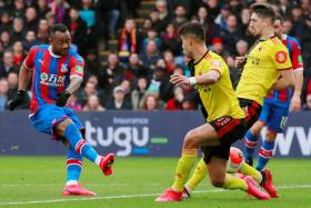 Crystal Palace striker Jordan Ayew (left) scoring in a 1-0 win over Watford in March, when the English Premier League came to a halt due to the Covid-19 outbreak.