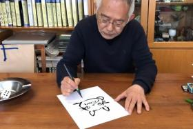 In this frame grab taken from undated handout video footage released by the Nagoya City Education Board Education Centre on May 12, 2020, Studio Ghibli producer Toshio Suzuki gives an online tutorial for drawing one of its characters 'Totoro' at his home in Tokyo.