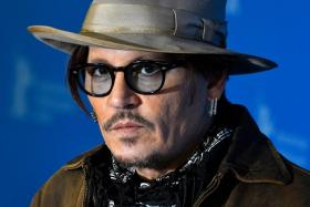 "In this file photo taken on February 21, 2020 US actor Johnny Depp poses during a photocall for the film ""Minamata"" screened in the Berlinale Special Gala on February 21, 2020 at the 70th Berlinale film festival in Berlin."