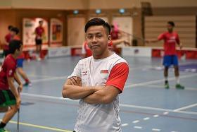 National men's floorball coach Lim Jin Quan wears an extra hat