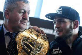 MMA fighter Khabib Nurmagomedov (right) and his father Abdulmanap at a press conference in Moscow in November 2018.