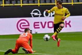 Thorgan Hazard scoring in a 4-0 win over Schalke 04 last weekend. The Belgium international attacker, who replaced the injured Giovanni Reyna just before the game kicked off, also suffered an injury.