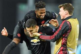 Manchester United players celebrating their 5-0 win over LASK Linz in the Europa League Round of 16, first-leg clash in Austria on March 12. The match, played behind closed doors, was the last game United played before their football season was brought to a halt due to the Covid-19 pandemic.