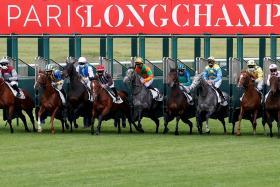 Jockeys wearing masks at Longchamp during Monday's meeting.