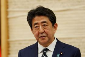 Japan PM lifts state of emergency, praises 'Japan model'