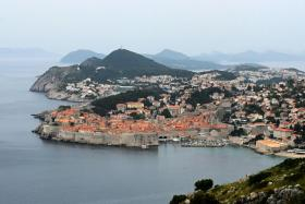 """This picture taken on May 17, 2020, shows a general view of the old town of the city of Dubrovnik, on the Adriatic coast of Croatia. - Less than two months after detecting its first infection, Montenegro is the first country in Europe to declare itself coronavirus-free, a success story the tiny country hopes will lure tourists to its dazzling Adriatic coast this summer. Tourism operators have already seized the opportunity to brand Montenegro as """"Europe's First COVID-19 Free Country"""" in videos promoting its stunning natural beauty, with beaches snaking along the south and rugged mountains in the north. Up the coast, tourism powerhouse Croatia is also hoping to capitalise on its relatively low virus numbers to salvage the 2020 season."""