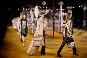 In this file photo taken on September 16, 2019 models present creations during a catwalk show for the Burberry Spring/Summer 2020 collection on the fourth day of London Fashion Week.