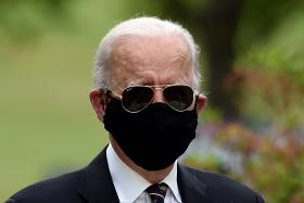 Biden calls Trump 'absolute fool' for not wearing a mask