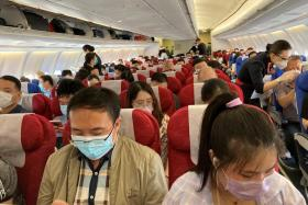 Passengers wearing face masks following the coronavirus disease (COVID-19) outbreak are seen on a China Eastern Airlines flight at Shenzhen Baoan International Airport in Shenzhen, Guangdong province, China May 19, 2020.