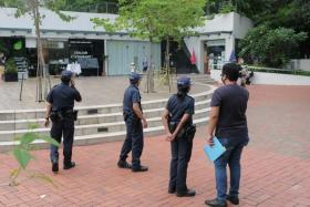 The police patrolling the park connector along Robertson Quay on May 17, the day when the Urban Redevelopment Authority banned the sale of take-away alcohol at 10 establishments in the area.