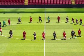 """Liverpool's players """"taking a knee"""" during a training session, sending out a powerful message against racism."""