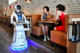 A robot serves in a Chinese restaurant to reduce the risk of spreading the coronavirus disease (COVID-19) in Maastricht, Netherlands, June 2, 2020.