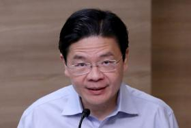 Phased opening to protect lives and livelihoods: Lawrence Wong