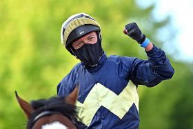 A masked Frankie Dettori after winning on Galsworthy on Tuesday