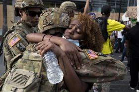 US protesters march for eighth night, but violence subsides