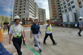 Minister of State for Manpower Zaqy Mohamed (in blue) visiting a construction site in Bukit Panjang in 2018.