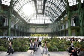 In this file photo taken on January 21, 2020 Models present creations by Chanel at the end of the Women's Spring-Summer 2020/2021 Haute Couture collection fashion show at the Grand Palais in Paris.