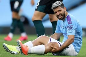 Manchester City manager Pep Guardiola fears striker Sergio Aguero (above) could miss the rest of the season.