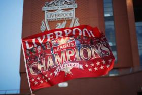 Ecstatic Liverpool FC celebrate outside Anfield stadium in Liverpool, Britain, 25 June 2020