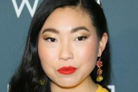 In this file photo taken on January 12, 2020 US actress Awkwafina arrives for the 25th Annual Critics' Choice Awards at Barker Hangar Santa Monica airport in Santa Monica, California.