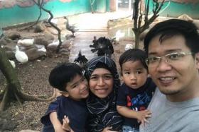 Ms Aisyah Amdan and her family. Her older son, Andi Muzaffar, will be entering Primary 1 next year.