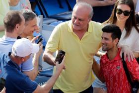 Novak Djokovic (in red) engaging fans at June's Adria Tour tennis tournament in Belgrade, Serbia.