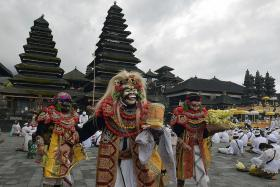 Indonesia's daily death toll hits new high as Bali reopens