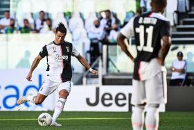 Juventus open seven-point gap as Ronaldo scores from free-kick