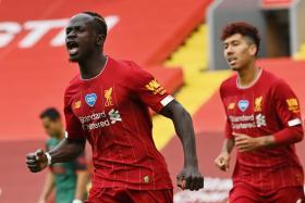 Sadio Mane celebrates after breaking the deadlock against Aston Villa.