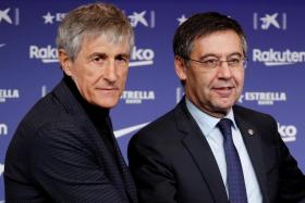 Barcelona president Josep Maria Bartomeu (right) replaced coach Ernesto Valverde, who led the Catalan giants to successive La Liga titles, with Quique Setien (left) in January.